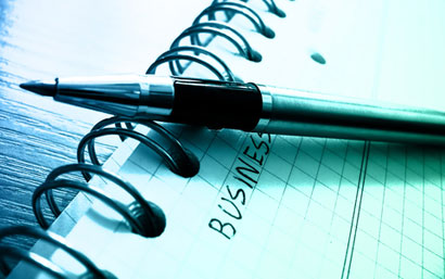 Image of pen and notebook with word business