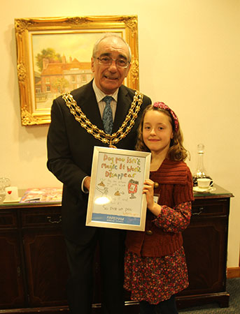 Picture of the Mayor with Camilla, presentating a framed copy of her dog fouling poster.