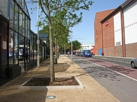 View of Harper Way showing new railings and trees in tree pits on new surfacing