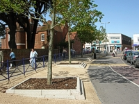 An image of the bus station showing newly surfaced pavements and newly planted trees.