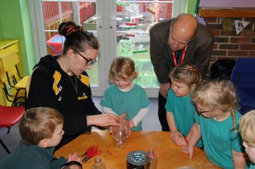 L to R: James, Nathalie, Ella, Cllr Martin, Mackenzie, Mila and Beth learning how to make plant pots out of plastic bottles