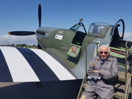 Sqn Ldr, Alan Frost preparing to fly a spitfire